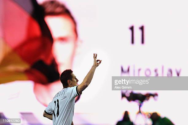 Miroslav Klose of Germany celebrates his team's first goal during the EURO 2012 Group A qualifier match between Germany and Kazakhstan at...