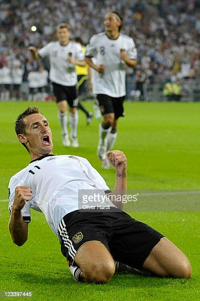 Miroslav Klose of Germany celebrates his team's first goal during the UEFA EURO 2012 qualifying match between Germany and Austria at VeltinsArena on...
