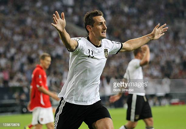 Miroslav Klose of Germany celebrates his team's first goal during the UEFA EURO 2012 qualifying match between Germany and Austria at Veltins-Arena on...