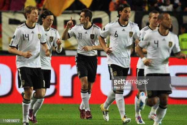 Miroslav Klose of Germany celebrates his team's first goal with team mates during the EURO 2012 Group A qualifier match between Germany and...
