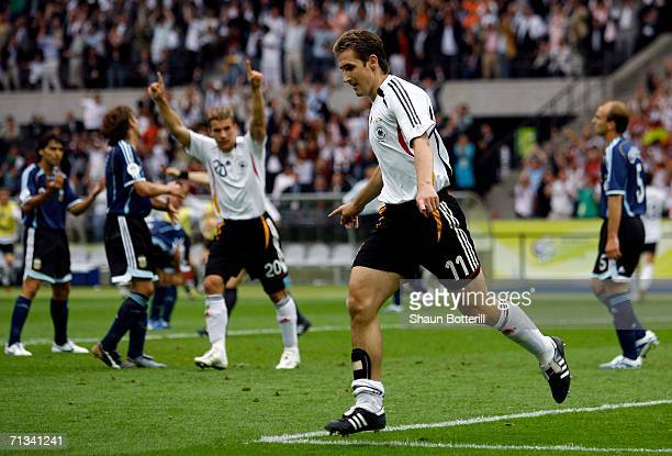 Miroslav Klose of Germany celebrates scoring an equalising goal during the FIFA World Cup Germany 2006 Quarter-final match between Germany and...
