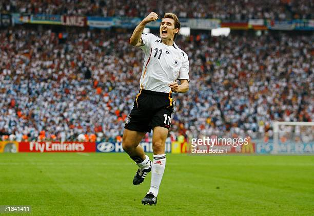 Miroslav Klose of Germany celebrates scoring an equalising goal during the FIFA World Cup Germany 2006 Quarterfinal match between Germany and...