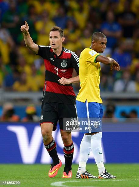 Miroslav Klose of Germany celebrates scoring his team second goal during the 2014 FIFA World Cup Brazil Semi Final match between Brazil and Germany...