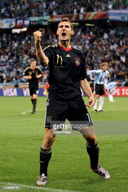 Miroslav Klose of Germany celebrates scoring his team's fourth goal during the 2010 FIFA World Cup South Africa Quarter Final match between Argentina...