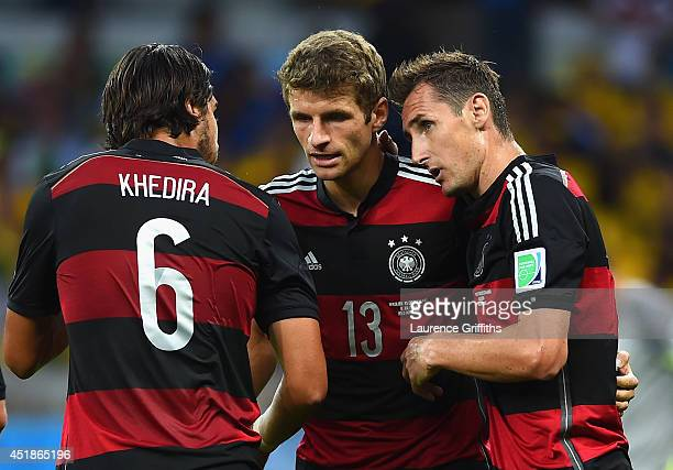 Miroslav Klose of Germany celebrates scoring his team's second goal with teammates Sami Khedira and Thomas Mueller during the 2014 FIFA World Cup...