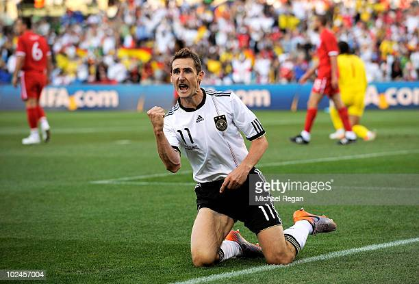 Miroslav Klose of Germany celebrates scoring the opening goal during the 2010 FIFA World Cup South Africa Round of Sixteen match between Germany and...