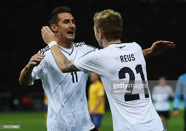Miroslav Klose of Germany celebrates with his team mate Marco Reus after scoring his team's first goal during the FIFA 2014 World Cup qualifier group...