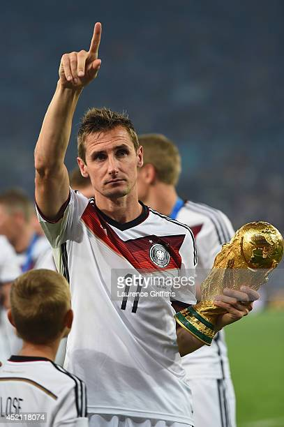 Miroslav Klose of Germany celebrates with the World Cup trophy after defeating Argentina 10 in extra time during the 2014 FIFA World Cup Brazil Final...