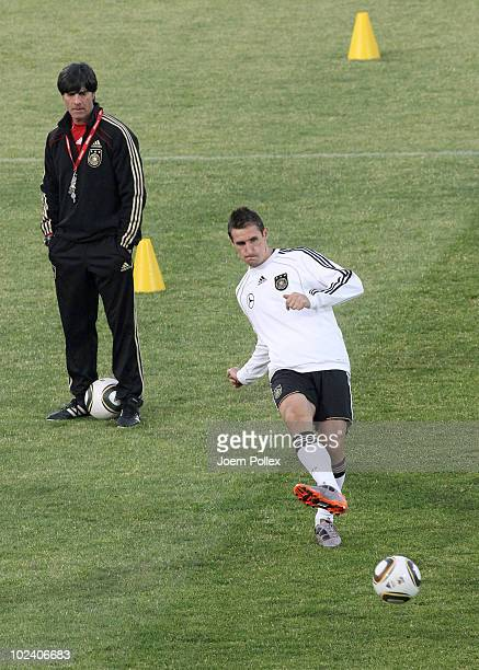 Miroslav Klose of Germany controls the ball in front of head Joachim Loew during a training session at Super stadium on June 25, 2010 in Pretoria,...