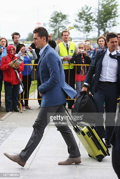 Miroslav Klose of Germany departs for their UEFA EURO 2012 semifinal match against Italy at Lech Walesa Airport at Lech Walesa Airport on June 27...