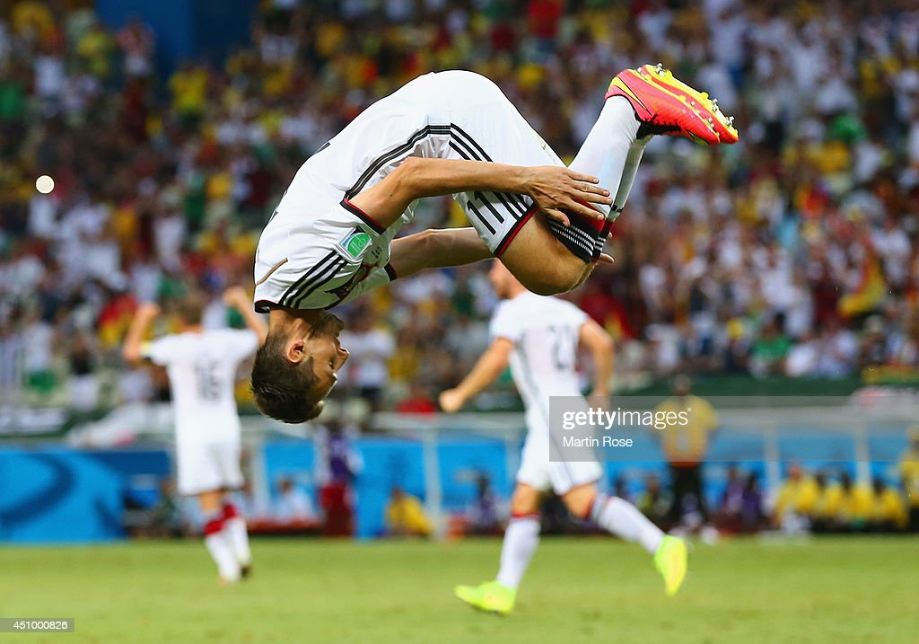 Miroslav Klose of Germany does a flip in celebration of scoring his team's second goal during the 2014 FIFA World Cup Brazil Group G match between Germany and Ghana at Castelao on June 21, 2014 in Fortaleza, Brazil.