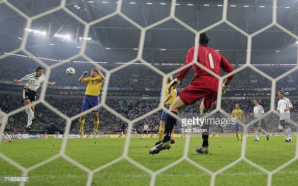 Miroslav Klose of Germany heads the third goal during the friendly match between Germany and Sweden at the Arena Auf Schalke on August 16 2006 in...