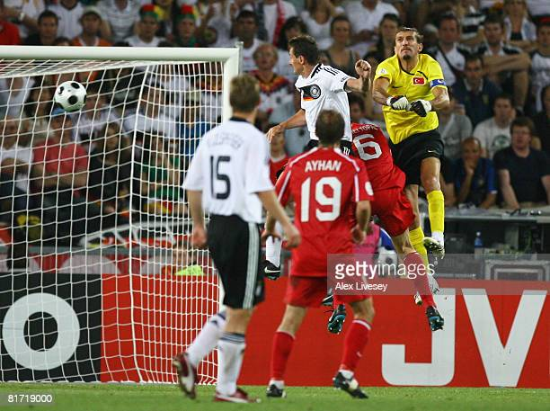 Miroslav Klose of Germany heads their second goal during the UEFA EURO 2008 Semi Final match between Germany and Turkey at St JakobPark on June 25...