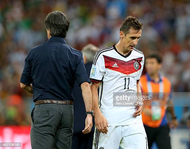 Miroslav Klose of Germany interacts with head coach Joachim Loew of Germany as he is replaced during the 2014 FIFA World Cup Brazil Final match...