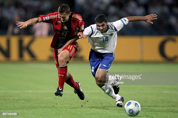 Miroslav Klose of Germany is challenged by Rashad Sadigov of Aserbaijan during the FIFA 2010 World Cup Group 4 Qualifier match between Azerbaijan and...