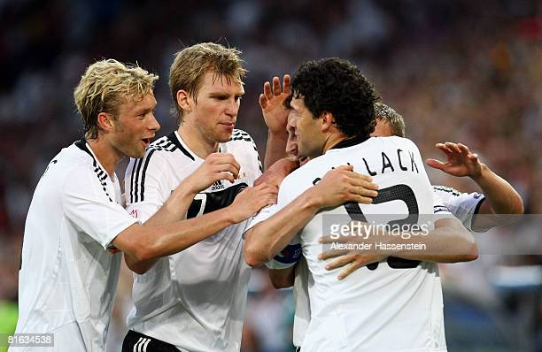 Miroslav Klose of Germany is mobbed by team mates Michael Ballack, Per Mertesacker and Simon Rolfes after scoring his teams second goal during the...