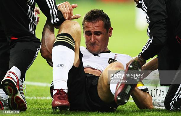 Miroslav Klose of Germany lies injured on the pitch during the international charity match between Germany and Uruguay at RheinNeckar Arena on May 29...