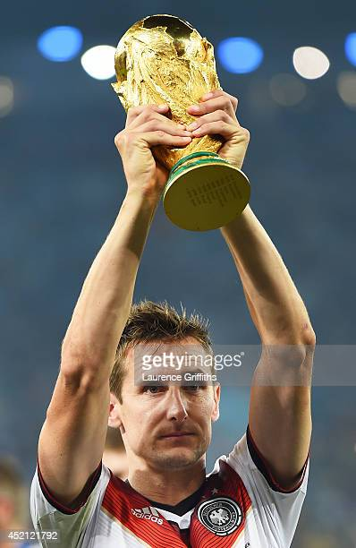 Miroslav Klose of Germany raises the World Cup trophy after defeating Argentina 1-0 in extra time during the 2014 FIFA World Cup Brazil Final match...