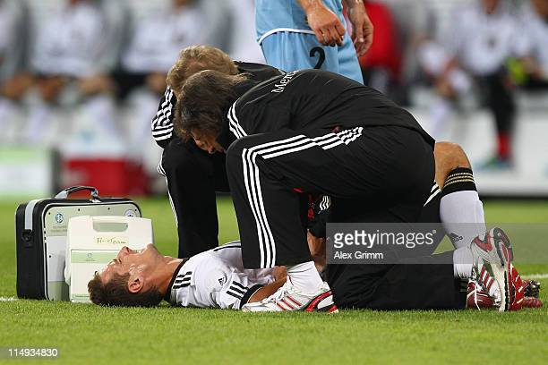 Miroslav Klose of Germany receives treatment during the international friendly charity match between Germany and Uruguay at RheinNeckar Arena on May...