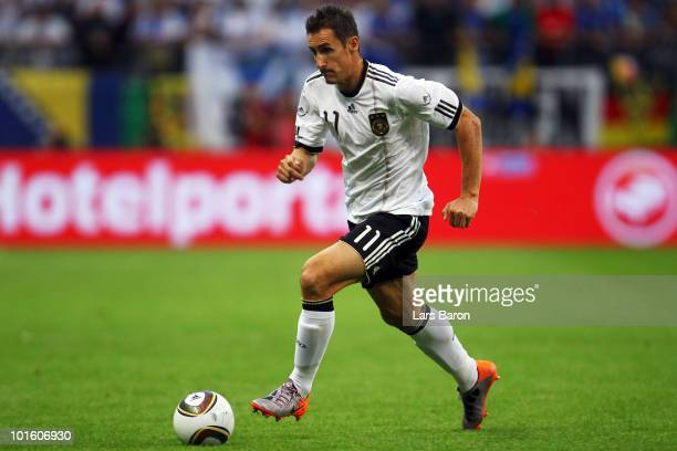 Miroslav Klose of Germany runs with the ball during the international friendly match between Germany and Bosnia-Herzegovina at Commerzbank Arena on...