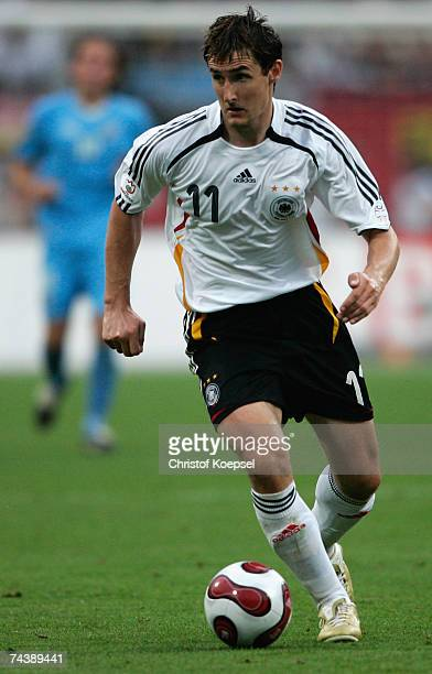 Miroslav Klose of Germany runs with the ball during the UEFA EURO 2008 qualifier between Germany and San Marino at the Easy Credit stadium on June...