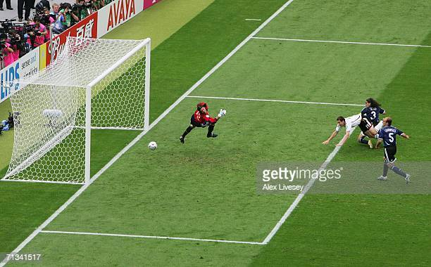 Miroslav Klose of Germany scores an equalising goal during the FIFA World Cup Germany 2006 Quarterfinal match between Germany and Argentina played at...