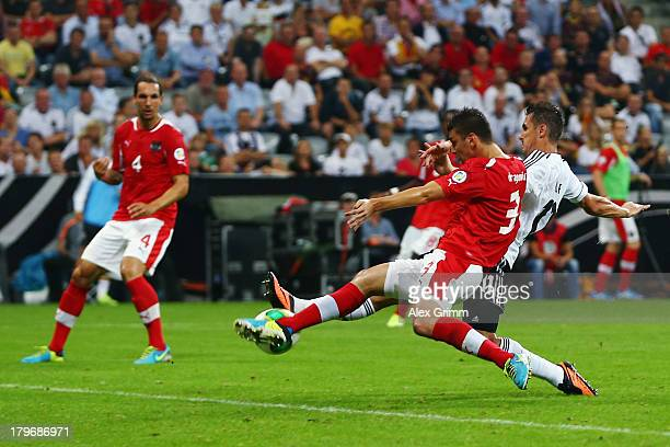 Miroslav Klose of Germany scores his team's first goal against Aleksandr Dragovic of Austria during the FIFA 2014 World Cup Group C qualifying match...