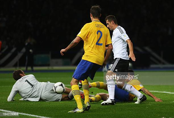 Miroslav Klose of Germany scores his team's second goal during the FIFA 2014 World Cup qualifier group C match between German and Sweden at...