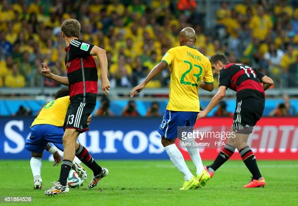 Miroslav Klose of Germany scores his team's second goal during the 2014 FIFA World Cup Brazil Semi Final match between Brazil and Germany at Estadio...