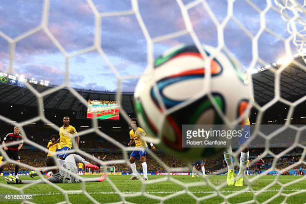 Miroslav Klose of Germany scores his team's second goal past Julio Cesar of Brazil during the 2014 FIFA World Cup Brazil Semi Final match between...