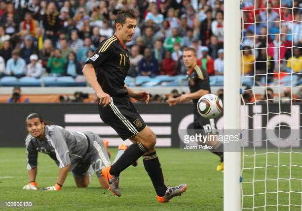Miroslav Klose of Germany scores his team's second goal past Sergio Romero of Argentina during the 2010 FIFA World Cup South Africa Quarter Final...