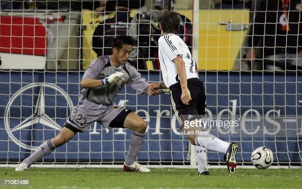 Miroslav Klose of Germany scores the third goal during the international friendly match between Germany and Japan at the BayArena on May 30, 2006 in...