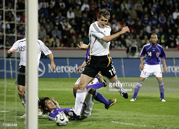 Miroslav Klose of Germany scors the a goal during the International Friendly match between Germany and Japan at the Bayarena on May 30, 2006 in...