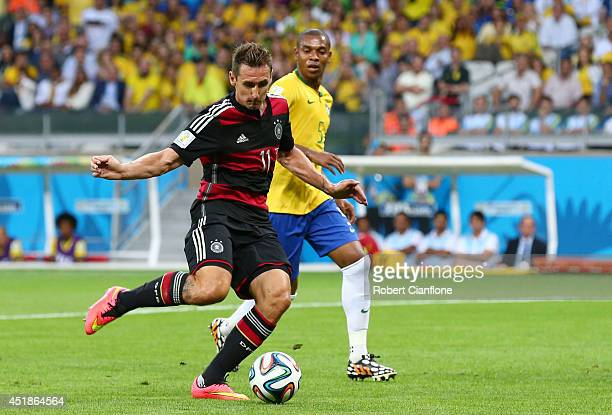 Miroslav Klose of Germany shoots and scores his team's second goal during the 2014 FIFA World Cup Brazil Semi Final match between Brazil and Germany...