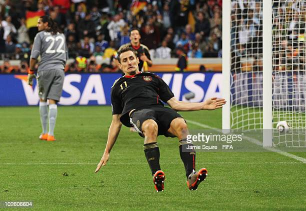 Miroslav Klose of Germany somersaults in celebration as he scores their fourth goal during the 2010 FIFA World Cup South Africa Quarter Final match...