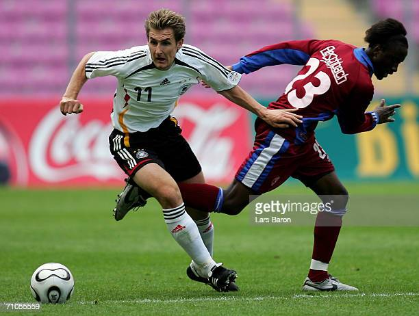 Miroslav Klose of Germany takes the ball past Milton Kusunga during the test match between the A Juniors of Servette Geneva and the German National...