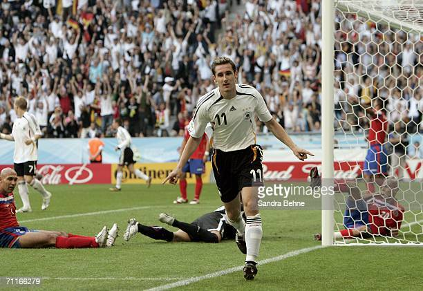 Miroslav Klose of Germany turns away in celebration after scoring his teams third goal during the FIFA World Cup Germany 2006 Group A match between...