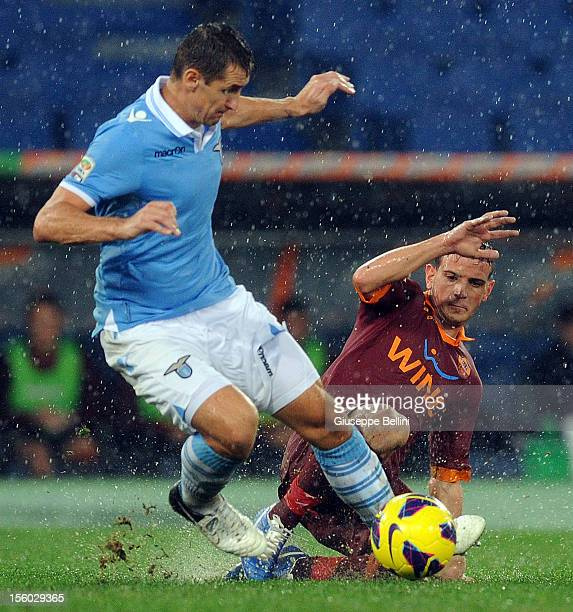 Miroslav Klose of Lazio and Alessandro Florenzi of Roma in action during the Serie A match between SS Lazio and AS Roma at Stadio Olimpico on...