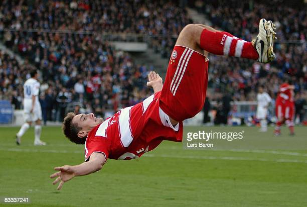 Miroslav Klose of Munich celebrates scoring the first goal with a flip during the Bundesliga match between Karlsruher SC and FC Bayern Muenchen at...