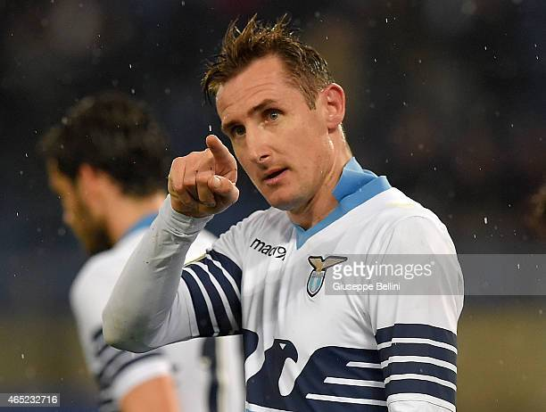 Miroslav Klose of SS Lazio celebrates after scoring the opening goal during the TIM Cup match between SS Lazio and SSC Napoli at Stadio Olimpico on...