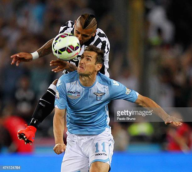 Miroslav Klose of SS Lazio competes for the ball with Arturo Vidal of Juventus FC during the TIM Cup final match at Olimpico Stadium on May 20 2015...