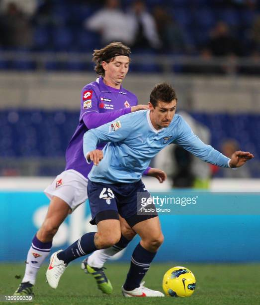 Miroslav Klose of SS Lazio competes for the ball with Riccardo Montolivo of ACF Fiorentina during the Serie A match between SS Lazio and ACF...