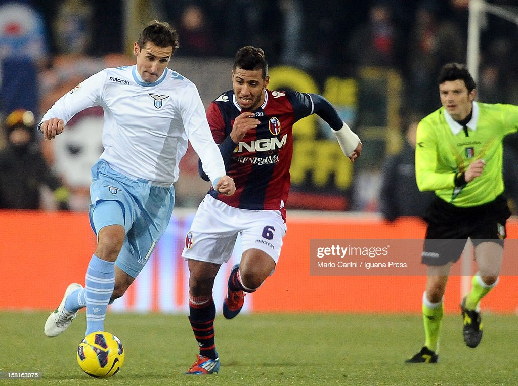 Miroslav Klose # 11 of SS Lazio ( L ) competes the ball with Saphir Taider # 6 of Bologna FC ( R ) during the Serie A match between Bologna FC and S.S. Lazio at Stadio Renato Dall'Ara on December 10, 2012 in Bologna, Italy.