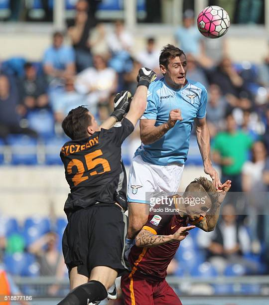 Miroslav Klose of SS Lazio scores the team's first goal during the Serie A match between SS Lazio and AS Roma at Stadio Olimpico on April 3 2016 in...