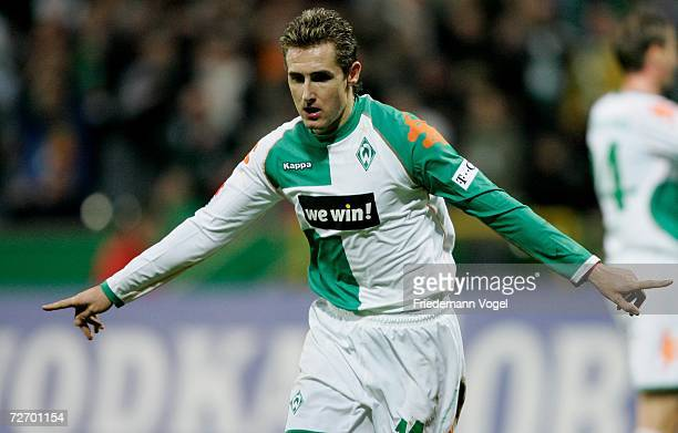 Miroslav Klose of Werder celebrates scoring the third goal during the Bundesliga match between Werder Bremen and Hertha BSC Berlin at the Weser...