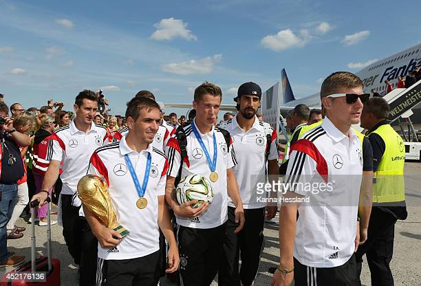Miroslav Klose Philipp Lahm Lars Bender Sami Khedira and Toni Kroos with the cup and ball as the German national team return after winning the 2014...