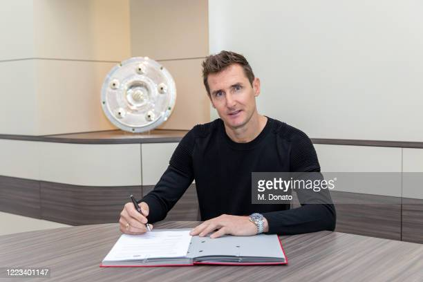 Miroslav Klose poses as he signs his new contract as assistant coach of FC Bayern Muenchen on May 07, 2020 in Munich, Germany. Klose will be head...