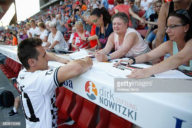 Miroslav Klose signs autographs after the 'Champions for charity' football match between Nowitzki All Stars and Nazionale Piloti in honor of Michael...