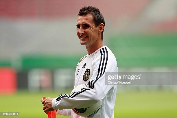 Miroslav Klose smiles during a training session of the German National football team at MercedesBenz Arena on August 8 2011 in Stuttgart Germany...