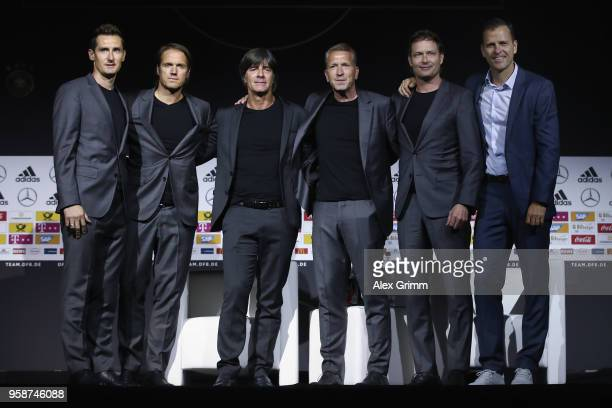Miroslav Klose Thomas Schneider Joachim Loew Andreas Koepke Marcus Sorg and Oliver Bierhoff pose during the presentation of the provisional squad of...